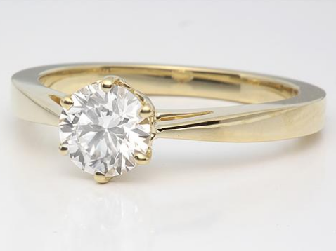 solitaire engagement ring with tapered band in 18k yellow