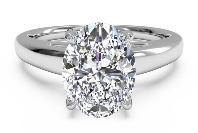 Platinum Solitaire Engagement Ring with Surprise Diamonds