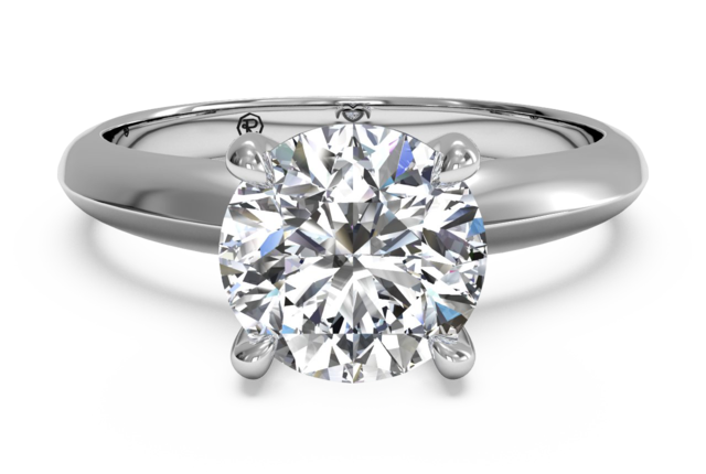 Surprise Diamond Solitaire Knife-Edge Engagement Ring in Platinum