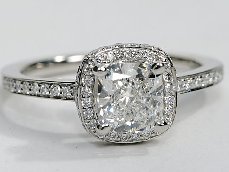halo engagement ring with pave diamonds in platinum