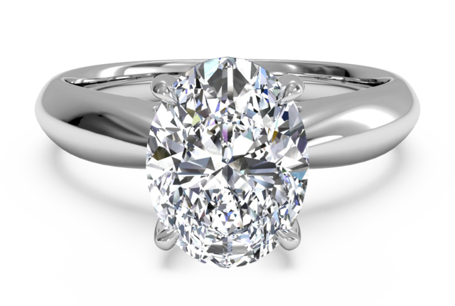Tapered Solitaire Engagement Ring with Surprise Diamonds in Platinum