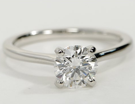Thin Petite Solitaire Engagement Ring in Platinum